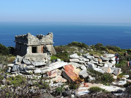 "the ruins of the Fortress Observation Posts. Disguised with fake stone facade. Built during 'World War 2 (1939-45) and formed the anti-submarine ""Diaz Point"" observation post manned by members of the 2nd Heavy Battery of Simons Town Command, watching for German U-boats."