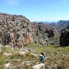 Johan is a tiny spek on the high rocks while we slowly climb up...