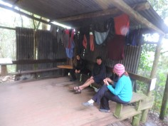 Relaxing under washing at the fire at Gwiligwili hut