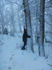 Tree hugging in snow is magical