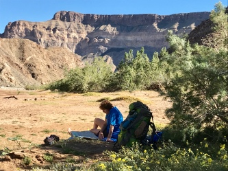 Studying the Fish River Map during a quick break