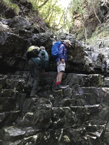 Climbing up past lower waterfall at Hell's Gate